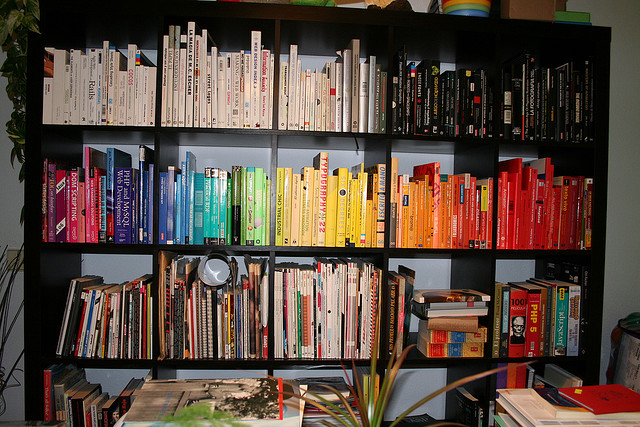 Books arranged by color.